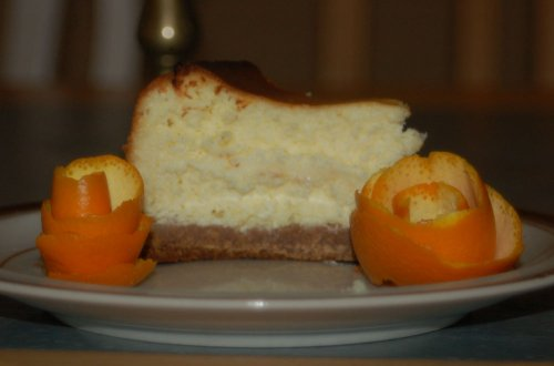 Cheese Cake slice with orange slice roses