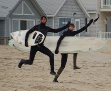 Surfers Waving