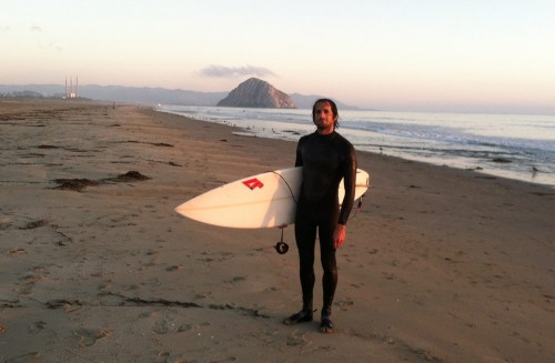 Here I am looking very enthusiastic after 1 out of the 5 surfs I had in August. Note the lack of waves in the background.