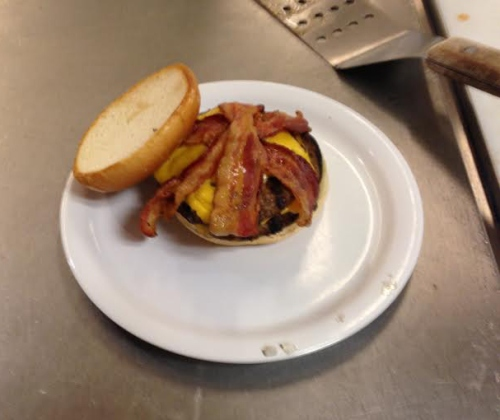 Reaping the fruits of my labor.  Your looking at a bacon double cheese burger for yours truly.  You think I would feed the customer this well, as if.  Yes that is a plastic plate on top a 350 degree F flat top grill.  Safety as always is my number one concern.